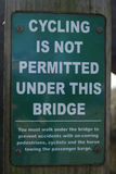 Safety sign. Warning sign, Cycling is not permitted under this bridge Stock Images