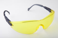 Safety or sport spectacles. Yellow safety or sport spectacles Stock Photography