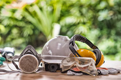 Safety standard set on working table and construction background. High Dynamic Range tone royalty free stock image