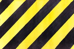 Safety stripes on construction site, Black and yellow Under construction sign over a grunge texture, top view Stock Images