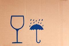 Safety symbols on cardboard Stock Images