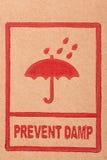 Safety symbols on cardboard Royalty Free Stock Photo