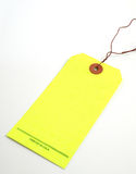 Safety Tag. Blank neon yellow safety tag royalty free stock image