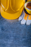 Safety tape building helmet and protective gloves Stock Photo