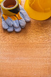 Safety tape hard hat and protective gloves on Stock Image
