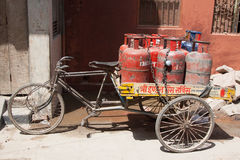 Safety transportation in India. Tricycle with gas bottles. Varanasi, Uttar Pradesh, India Royalty Free Stock Photos