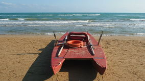 Safety twin-hulled rowboat beach. Safety twin-hulled rowboat on the beach stock video footage