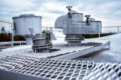 Safety valve on the storage tank Royalty Free Stock Photos