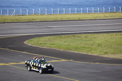Safety vehicle on an airport runaway near the ocean. Azores Royalty Free Stock Photos