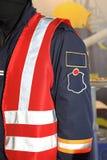 Safety Vest. Red Safety Vest at Man in Uniform stock images