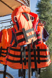 Safety vests orange save people's lives Royalty Free Stock Photos