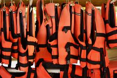 Safety vests. Red vests of safety for sea sports weigh in a row Stock Images