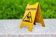 Safety. Warning sign sign slippery cleaning equipment yellow trip hazard sign stock image