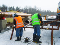 Safety at work. Welding and grinding of iron constructions. Industrial weekdays welders and fitters.  stock images