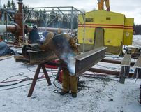 Safety at work. Welding and grinding of iron constructions. Industrial weekdays welders and fitters.  stock photography