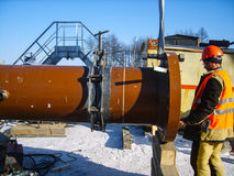 Safety at work. Welding and installation of the pipeline. Indust Stock Images