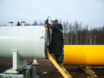 Safety at work. Welding and installation of the pipeline. Industrial weekdays welders and fitters. Safety at work. Welding and grinding of iron constructions royalty free stock photos