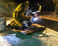 Safety at work. Welding and installation of the pipeline. Industrial weekdays welders and fitters. Safety at work. Welding and grinding of iron constructions royalty free stock images