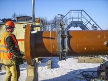 Safety at work. Welding and installation of the pipeline. Indust. Rial weekdays welders and fitters Royalty Free Stock Photo