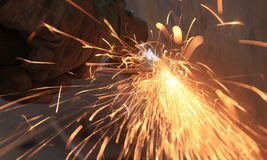 Safety worker grinding steel with a lot of sparkle Royalty Free Stock Photo