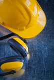 Safety yellow headphones and work helmet on Stock Photo