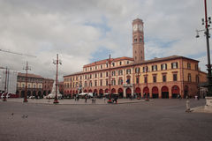 Saffi square in Forli, Italy. FORLI, ITALY - MARCH 16, 2014: people in the Saffi square at noon with a view of the Town Council Stock Images