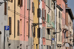 Saffi street, parma. Foreshortening of windows of ancient residential buildings aligned on the street in parma citycenter Stock Photo