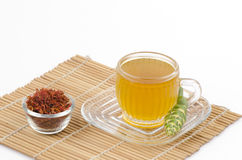 Safflower, False Saffron, Saffron Thistle (Carthamus tinctorius Linn.) And Safflower water. Stock Image