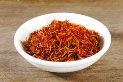 Safflower in white bowl Stock Photos