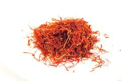 Saffron. Strands of saffron to flavor isolated on white background Royalty Free Stock Image