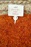 Saffron. A pile of dried saffron labeled in Arabic, Hebrew, and English, fills a bin in a spice and dry goods store in Nazareth, Israel Stock Photo