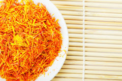 Saffron leaves spice on mat above view Stock Images