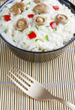 Saffron Milk Cap mushroom rice on a bowl on a bamboo mat Stock Photography