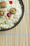 Saffron Milk Cap mushroom rice on a bowl on a bamboo mat Royalty Free Stock Photos