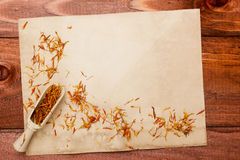 Saffron petals on an old piece of paper Royalty Free Stock Images
