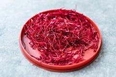 Saffron in Red Plastic Cup /Red Threads Kesar, Saffron, Crocus Sativus. Organic Product stock image