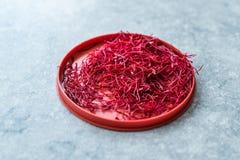 Saffron in Red Plastic Cup /Red Threads Kesar, Saffron, Crocus Sativus. Organic Product stock photo