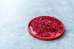Saffron in Red Plastic Cup /Red Threads Kesar, Saffron, Crocus Sativus. Organic Product stock photography