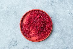 Saffron in Red Plastic Cup /Red Threads Kesar, Saffron, Crocus Sativus. Organic Product stock images