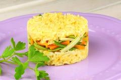 Saffron rice with crunchy vegetables Stock Photo