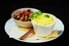 Saffron rice and fried turkey with pepper stock photography