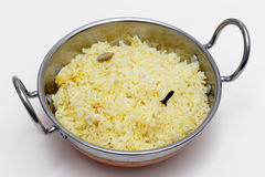 Saffron rice in a kadai bowl Stock Image