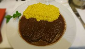 Saffron risotto and braised beef royalty free stock image