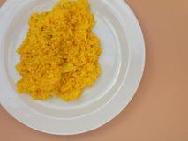 Saffron risotto in a dish. Saffron risotto made with Carnaroli rice, medium grained rice grown Royalty Free Stock Photo