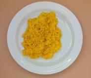 Saffron risotto in a dish. Saffron risotto made with Carnaroli rice, medium grained rice grown Stock Photos