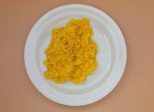 Saffron risotto in a dish. Saffron risotto made with Carnaroli rice, medium grained rice grown Stock Photo