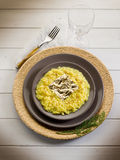 Saffron risotto with gold leaf Royalty Free Stock Photo
