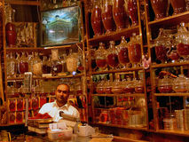 Saffron shop, Mashad. Salesman selling saffron, the most expensive spice in the world in his shop in Mashad. Iran is the largest producer of saffron with 93,7% Royalty Free Stock Images