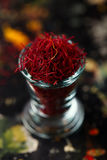 Saffron space threads in vintage glass bowl Stock Images