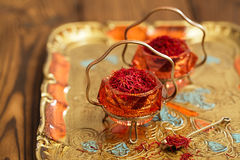 Saffron spice in antique vintage glass bowl Royalty Free Stock Images